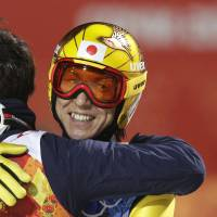 Photo - Japan's Noriaki Kasai smiles after winning the bronze during the ski jumping large hill team competition at the 2014 Winter Olympics, Monday, Feb. 17, 2014, in Krasnaya Polyana, Russia. (AP Photo/Matthias Schrader)