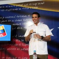 Photo - Venezuela's opposition leader Henrique Capriles arrives for a news conference at his office in Caracas, Venezuela, Wednesday, April 24, 2013. Capriles urged Venezuela's electoral commission to begin the audit of the April 14, 2013 disputed presidential vote, that handed Capriles's rival, Nicolas Maduro, a razor-thin victory. (AP Photo/Fernando Llano)