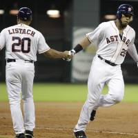 Photo - Houston Astros' Jon Singleton (28) is congratulated by third base coach Tarrik Brock after hitting a home run to right field during the third inning of a baseball game against the Arizona Diamondbacks, Thursday, June 12, 2014, in Houston. (AP Photo/Patric Schneider)
