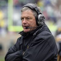 Photo -   FILE - In this Oct. 13, 2012, file photo, Iowa coach Kirk Ferentz walks the sidelines during the third quarter of an NCAA college football game against Michigan State in East Lansing, Mich. Iowa isn't giving up on Ferentz despite a third straight season of diminishing returns. The Hawkeyes simply have to hope that the well-respected coach who has twice revived the program has another turnaround in him. (AP Photo/Al Goldis, File)