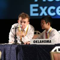 Photo -  Team Oklahoma competitor Finn Bender checks his microphone during the introduction to the National Finals game at the National Tournament of Academic Excellence on June 17 in Orlando. Photo by David Brame, Dynamx Digital   Dynamx Digital -  Photos by David Brame, Dynamx Digital.