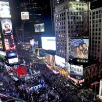 Photo - FILE - In this Dec. 31, 2011 file photo, the crowd packs New York's Times Square during the New Year's Eve celebration as seen from the Marriott Marquis hotel. It's no small task making sure the annual celebration remains safe, but the New York City police use an array of security measures for the event that turns the
