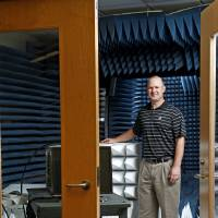 Photo - Nathan Goodman stands inside a room that was converted into an anechoic chamber inside the National Weather Center in the campus of the University of Oklahoma in Norman, Okla., Tuesday, April 10, 2012. Photo by Bryan Terry, The Oklahoman