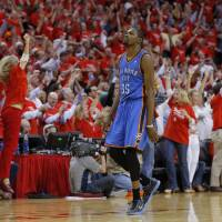 Photo - Oklahoma City's Kevin Durant (35) walks off the court as the crowd reacts to Houston's win in Game 4 in the first round of the NBA playoffs between the Oklahoma City Thunder and the Houston Rockets at the Toyota Center in Houston, Texas,Sunday, April 29, 2013. Oklahoma City lost 105-103. Photo by Bryan Terry, The Oklahoman