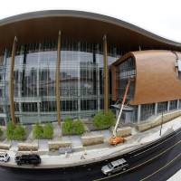 Photo - This April 29, 2013, photo made with a fisheye lens shows the Music City Center in Nashville, Tenn. Nashville's new convention center is transforming the look of downtown with its wavy roof dominating six city blocks, but tourism officials hope the eye-catching facility will also show business travelers a revitalized Music City. (A P Photo/Mark Humphrey)