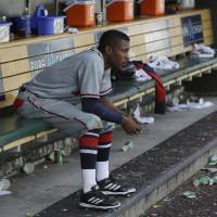 Photo - Atlanta Braves' B.J. Upton sits in the dugout after their 7-4 loss to the Detroit Tigers in an interleague baseball game in Detroit, Saturday, April 27, 2013. Upton struck out in the ninth inning for the Braves. (AP Photo/Carlos Osorio)