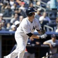 Photo - New York Yankees' Brian McCann follows through with a two-run home run during the sixth inning of a baseball game against the Boston Red Sox Saturday, April 12, 2014, in New York. (AP Photo/Frank Franklin II)