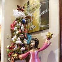 Photo - A whimsical angel stands near the entrance to Mike and Debbie McCurdy's home, one of five homes on the Assistance League of Norman's annual Holiday Home Tour. PHOTO BY STEVE SISNEY, THE OKLAHOMAN  STEVE SISNEY