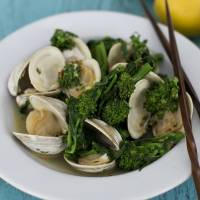 Photo - In this image taken on Feb. 11, 2013, Asian steamed clams or mussels with broccoli rabe is shown served in a bowl in Concord, N.H. (AP Photo/Matthew Mead)