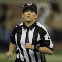 Photo -   Line judge Shannon Eastin runs on the field during the first quarter of an NFL football game between the Detroit Lions and the St. Louis Rams in Detroit, Sunday, Sept. 9, 2012. (AP Photo/Carlos Osorio)