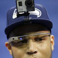 Photo - Seattle Seahawks' Golden Tate wears Google glasses during media day for the NFL Super Bowl XLVIII football game Tuesday, Jan. 28, 2014, in Newark, N.J. (AP Photo/Matt Slocum)