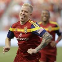 Photo - Real Salt Lake's Luke Mulholland celebrates after scoring a goal against the Montreal Impact during the first half of an MLS soccer game on Thursday, July 24, 2014, in Sandy, Utah. (AP Photo/Rick Bowmer)