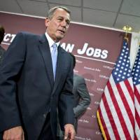 Photo - House Speaker John Boehner, of Ohio, and the House GOP leadership leave after a news conference on Capitol Hill in Washington, Wednesday, Dec. 5, 2012, following a closed-door GOP strategy session. At left is Rep. Cathy McMorris Rodgers, R-Wash. (AP Photo/J. Scott Applewhite)