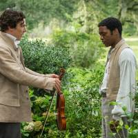 Photo - This film publicity image released by Fox Searchlight shows Benedict Cumberbatch, left, and Chiwetel Ejiofor in a scene from