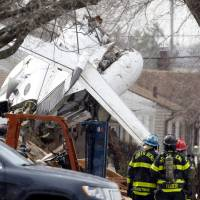 Photo - Wreckage is shown March 19, two days after a private jet crashed into a home near the South Bend Regional Airport in South Bend, Ind. Former University of Oklahoma quarterback Steve Davis died in the crash. AP PHOTO