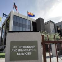 Photo - FILE – This Aug. 5, 2008, file photo, shows the U.S. Citizenship and Immigration Services building Phoenix. The U.S. Supreme Court will struggle this week with the validity of an Arizona law that tries to keep illegal immigrants from voting by demanding all state residents show documents proving their U.S. citizenship before registering to vote in national elections. (AP Photo/Matt York, File)