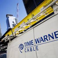 Photo - FILE - In this Feb. 2, 2009 file photo, a Time Warner Cable truck is parked in New York. Comcast has agreed to buy Time Warner Cable for $45.2 billion in stock, or $158.82 per share, in a deal that would combine the top two cable TV companies in the nation, according to a person familiar with the matter who spoke on condition of anonymity because it had not been announced formally. An announcement is set for Thursday morning, Feb. 13, 2014, the person said. (AP Photo/Mark Lennihan, File)