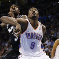 Photo - Oklahoma City Thunder forward Serge Ibaka (9) and San Antonio Spurs guard Stephen Jackson (3) fight for position during a foul shot in the fourth quarter of an NBA basketball game in Oklahoma City, Monday, Dec. 17, 2012. Oklahoma City won 107-93. (AP Photo/Sue Ogrocki) ORG XMIT: OKSO104