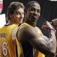 Photo -   Los Angeles Lakers forward Pau Gasol (16) and center Dwight Howard pose during their NBA basketball media day at the team's headquarters in El Segundo, Calif., Monday, Oct. 1, 2012. (AP Photo/Reed Saxon)