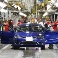 Photo - In this March 14, 2014 file photo, a 2015 Chrysler 200 automobile moves down the assembly line at the Sterling Heights Assembly Plant in Sterling Heights, Mich. Automakers report sales for May on Tuesday, June 3, 2014. All automakers report U.S. sales figures for August 2014 on Wednesday, Sept. 3, 2014. Chrysler and Nissan both posted double-digit U.S. sales gains last month, signs of strong August for the industry. (AP Photo/Paul Sancya, File)
