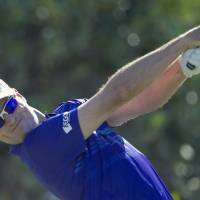 Photo - Zach Johnson drives off the first tee during the final round of the Tournament of Champions golf tournament, Monday, Jan. 6, 2014, in Kapalua, Hawaii. (AP Photo/Marco Garcia)