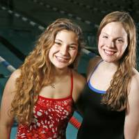 Photo - HIGH SCHOOL SWIMMING: High school swimmers Kasey Rein of Piedmont, left and Jessi Hildebrand of Newcastle pose for a photo at the Lighthouse in Oklahoma City, Thursday, Feb. 14, 2013. Photo by Nate Billings, The Oklahoman