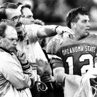 """Photo -  COLLEGE FOOTBALL: """"OSU head coach Pat Jones, left, talks with an assistant coach as quarterback Mike Gundy looks on Saturday"""" during the Oklahoma State University-Texas A&M game in Stillwater.  The Cowboys won handily, 52-15. Staff photo by Doug Hoke taken 9/24/88; photo ran in the 9/25/88 Daily Oklahoman."""