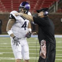 Photo -   TCU head coach Gary Patterson makes his point with TCU quarterback Casey Pachall (4) during the fourth quarter of a NCAA college football game on Saturday, Sept. 29, 2012, in Dallas. TCU won 24-16. (AP Photo/John F. Rhodes)