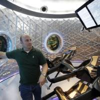 Photo - Garrett Reisman, program lead for crew vehicles of the SpaceX, stands inside the SpaceX Dragon V2 at the headquarters on Thursday, May 29, 2014, in Hawthorne, Calif. SpaceX, which has flown unmanned cargo capsules to the International Space Station, unveiled the new spacecraft Thursday designed to ferry astronauts to low-Earth orbit. (AP Photo/Jae C. Hong)