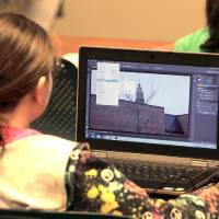 Photo - Girl Scout Junior Rachel Porter, of Troop 234, learns to use Photoshop during a digital photography class at the Oklahoma City University Intergenerational Computer Center.