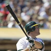 Photo -   Oakland Athletics' Seth Smith hits a home run off New York Yankees relief pitcher Rafael Soriano during the ninth inning of their baseball game Sunday, July 22, 2012 in Oakland, Calif. (AP Photo/Eric Risberg)