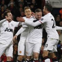 Photo - Manchester United's Wayne Rooney, second right, celebrates his goal against Crystal Palace with teammates during their English Premier League soccer match at Selhurst Park, London, Saturday, Feb. 22, 2014. (AP Photo/Sang Tan)
