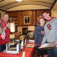 Photo -  OU quarterback Trevor Knight, right, served pancakes to fellow Headington Hall residents last year during a