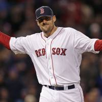 Photo - Boston Red Sox starting pitcher John Lackey reacts after getting Texas Ranger J.P. Arencibia to ground out to end the top of the seventh inning of a MLB American League baseball game at Fenway Park, Monday, April 7, 2014, in Boston.(AP Photo/Charles Krupa)