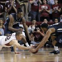 Photo - Temple's Dalton Pepper (32) and Villanova's Darrun Hillard (4) dive on a loose ball during the first half of an NCAA college basketball game on Saturday, Feb. 1, 2014, in Philadelphia. (AP Photo/Michael Perez)