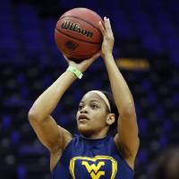 Photo - West Virginia center Asya Bussie shoots during practice at the NCAA women's college basketball tournament in Baton Rouge, La., Saturday, March 22, 2014. West Virginia faces Albany (N.Y.) in a first-round game on Sunday. (AP Photo/Rogelio V. Solis)
