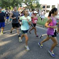 Photo -  Runners begin the 5K to Monet run last year in downtown Edmond. Photo by Paul Hellstern, The Oklahoman Archives   PAUL HELLSTERN -  Oklahoman