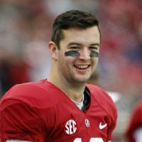 Photo - FILE - In this Nov. 23, 2012 file photo, Alabama quarterback AJ McCarron (10) watches from the sideline during the second half of an NCAA college football game against Chattanooga, in Tuscaloosa, Ala. McCarron made a pact with himself: He wouldn't go to New York before he's able to pay his own way unless it's for the Heisman Trophy ceremony or the NFL draft. He's headed there this weekend as a Heisman finalist. (AP Photo/Butch Dill, File)