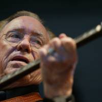 Photo -   FILE - In this June 10, 2005 file photo, Earl Scruggs, performs at the Bonnaroo Music & Arts Festival in Manchester, Tenn. Scruggs' son Gary said his father passed away Wednesday morning, March 28, 2012 at a Nashville, Tenn., hospital of natural causes. He was 88. (AP Photo/Eric Parsons, File)