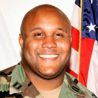 Photo - This undated photo released by the Los Angeles Police Department shows suspect Christopher Dorner, a former Los Angeles officer. Seeking leads in a massive manhunt, Los Angeles authorities on Sunday put up a $1 million reward for information leading to the arrest of Christopher Dorner, the former Los Angeles police officer suspected in three killings. (AP Photo/Los Angeles Police Department)