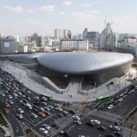 Photo - Dongdaemun Design Plaza is seen in downtown Seoul, South Korea, Friday, March 21, 2014.  The $450 million building funded by Seoul citizen's tax money finally opened to public on Friday after years of debates about transforming a historic area with an ultra-modern architecture. (AP Photo/Ahn Young-joon)