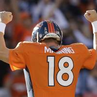 Photo - Denver Broncos quarterback Peyton Manning (18) reacts after throwing a touchdown pass to Denver Broncos defensive tackle Mitch Unrein (96) against the Tampa Bay Buccaneers in the first quarter of an NFL football game, Sunday, Dec. 2, 2012, in Denver. (AP Photo/Joe Mahoney)