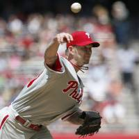 Photo - Philadelphia Phillies' A.J. Burnett throws a pitch against the Arizona Diamondbacks during the first inning of a baseball game on Sunday, April 27, 2014, in Phoenix. (AP Photo/Ross D. Franklin)
