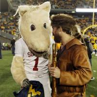 Photo - OU mascot Sooner and the West Virginia Mountaineer, Jonathan Kimble, talk before a college football game between the University of Oklahoma and West Virginia University on Mountaineer Field at Milan Puskar Stadium in Morgantown, W. Va., Nov. 17, 2012. Photo by Nate Billings, The Oklahoman