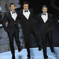 Photo - Actors, from left, Joseph Gordon-Levitt, host Seth MacFarlane and Daniel Radcliffe perform during the Oscars at the Dolby Theatre on Sunday Feb. 24, 2013, in Los Angeles.  (Photo by Chris Pizzello/Invision/AP)