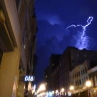 Photo - Lightning strikes over downtown in Knoxville, Tenn., on Sunday, July 27, 2014. Authorities say powerful storms crossing east Tennessee have destroyed 10 homes and damaged others, though there are no immediate reports of any deaths or injuries. (AP Photo/The Knoxville News Sentinel, Saul Young)
