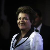 Photo - Brazil's President Dilma Rousseff arrives at La Moneda Palace for a work visit in Santiago, Chile, Saturday, Jan. 26, 2013. Leaders from the European Union, Latin America and the Caribbean gather in Santiago for the CELAC-EU economic summit Jan 26-27. (AP Photo/Luis Hidalgo)