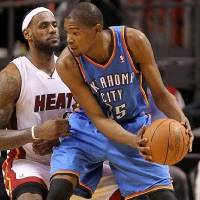 Photo -  Miami's LeBron James, left, is 8-2 in regular-season games against Kevin Durant.