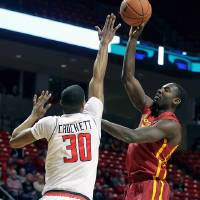 Photo - Iowa State's Dustin Hogue, right, shoots over Texas Tech's Jaye Crockett during an NCAA college basketball game in Lubbock, Texas, Saturday, Jan, 4, 2014. (AP Photo/The Avalanche-Journal, Zach Long)