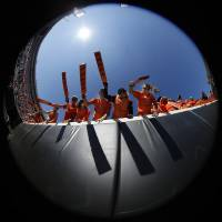 Photo - Paddle People cheer before a college football game between Oklahoma State University (OSU) and Texas Christian University (TCU) at Boone Pickens Stadium in Stillwater, Okla., Saturday, Oct. 27, 2012. Photo by Sarah Phipps, The Oklahoman